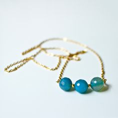 blue agate necklace - golden chain with golden pearls and round agates. €27.90, via Etsy.