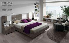 Dormitorio de matrimonio con un original y atractivo cabecero de cama