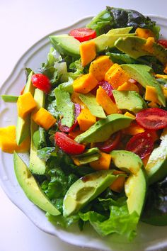 Avocado Mango and Tomato Salad by bhg: This easy dish brings to mind the beautiful fresh produce and tropical flavors of Guatemala. #Avocado #Healthy