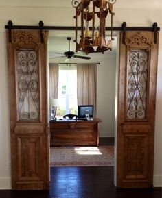 Our Antique French iron doors hung barn door style. Also, don't miss the custom desk designed from French antique doors!