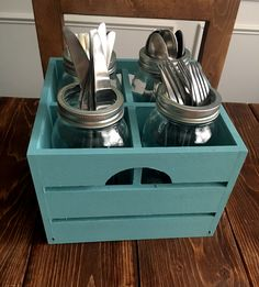 """This listing is for a wooden, hand-painted silverware caddy. It comes complete with 4 quart-sized mason jars, which you can use to hold silverware. Or you can use them to make a gorgeous flower arrangement! These make beautiful centerpieces for parties, showers, or every day dining.  Measurements: 9 x 9 x 6 1/4"""""""