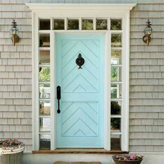 blue front door with gray toned shingles