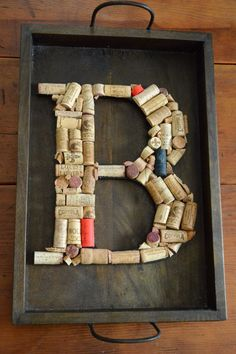 Repurposed wine cork art. I just might get creative--I could do a capital C on an old picture frame I have! Yay!