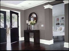Dark wood, gray walls and white trim. We have the dark wood and white trim, now just need the grey walls! Grey Walls White Trim, White Wood, Black Trim, Taupe Walls, Dark Gray Walls, Dark Grey Walls Living Room, Grey Trim, Black White, Black Accents