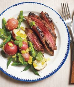 Pineapple-Marinated Steak With Spicy Potatoes and Green Beans recipe: To get dinner on the table faster, marinate the steak and prepare the potato salad up to 12 hours in advance.