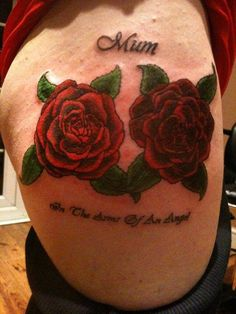 Red roses mum tattoo in the arms of an angel