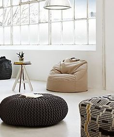 Add something different to your home with soft cushions and arm chairs like these contemporary designs from John Lewis