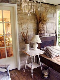 """...a sleeping porch with a chandelier, real furniture, and a """"bed"""" with weatherproof fabric? Yes, please. Love the exterior wall, too!"""