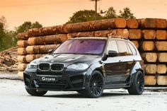 Black Pearl BMW SUV-- the only car I might consider selling my jeep for. . . .