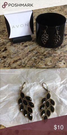 Avon stylish earrings Brand new earrings never worn black with gold trim. Avon Jewelry Earrings