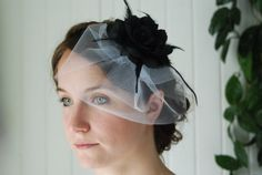 Bridal Flower Facinator with Birdcage Veil - Striking Black Flower with Feather Accents and White Tulle Birdcage Hair Clip Vintage Style  by A Modest Bit of Flair on Etsy