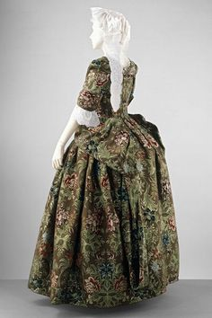 1732 (woven),1735-1740 (sewn), England - Gown and petticoat - Tabby ground silk brocaded with chenille thread, hand-sewn with 2 ply S spun silk thread.
