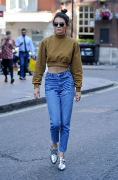 We've said it before and we'll say it again, mom jeans are totally chic. Case in point: Jenner in a cropped turtleneck sweater and high-waisted, slightly loose jeans while out and about in London.   - MarieClaire.com