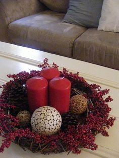a simple centerpiece--candles, a grapevine wreath, pinecones and red berries.  Need to try this for next Christmas