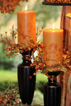 Autumn Décor.  I don't like the black but instead would do an antiqued white or cream with complimentary rubbed contrasts.  Take some decorative posts, paint them, and create a glowing light in your entry way or on dining table.