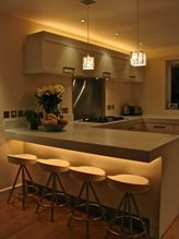 #Kitchen by #LightIQ. The #cube #pendant #lights allow for a sleek #lighting feature which is most useful over the #island/bar area. In addition, the #glow under the #breakfast #bar and above the cabinets is provided by #Linear #Powerflex in #2700k and adds layers of #light to this scheme.