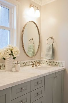 I dislike the backsplash here, but I love the cabinet color and countertop combination.  If you didn't want to do a neutral cabinet, this is a good option.