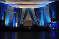 Blue and white Back drop, a little fancy for my tastes but good inspiration for a blue backdrop behind the head table