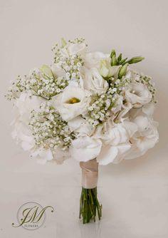 White theme wedding bouquet. White hydrangea, gypsophila and white lisianthus.