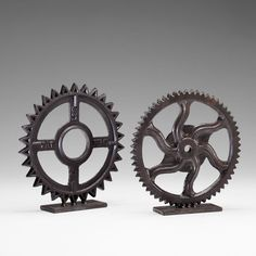 """Iron gear sculpture with bronze finish. (Right side gear in image)Dimensions: 11""""h x 2.75""""d x 10.75""""w"""