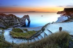 Dorset Spanning from Old Harry Rocks to Orcombe Point in Devon, the majority of the Dorset coastline lies within the Jurassic Coast district. Most Romantic Places, Most Beautiful Beaches, Beautiful Places, Amazing Places, Dorset Beaches, Lulworth Cove, Dorset England, Jurassic Coast, Epic Photos