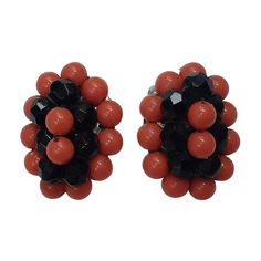 Elsa Schiaparelli 60s coral & black beads clip earrings. | From a unique collection of vintage clip-on earrings at https://www.1stdibs.com/jewelry/earrings/clip-on-earrings/ @1stdibscom #Schiaparelli #vintage #fashion