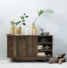 http://www.houzz.co.uk/photos/12071483/emmerson-sideboard-rustic-sideboards This is made from pallets - we could do that, and then maybe colour wash it to lighten it all up a bit.