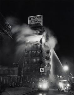 Simply Add Boiling Water Weegee [Arthur Fellig] A dramatic night-time fire at a New York City kitchen products factory provided Weegee with an opportunity to exhibit some wry humour. Most Famous Photographers, Great Photographers, New York Street, New York City, Creative Photography, Street Photography, White Photography, Landscape Photography, Monochrome Photography