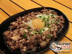 "This is Sisig. Sisig is one of the most well-known appetizers or ""pulutan"" in the Philippines and is served on a sizzling platter and topped with egg. See how to make it here: http://www.filipinochow.com/sisig/"