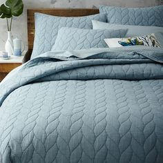 Braided Quilt + Shams | west elm. $189/quilt.  Mix & match shams/sheets in the frost & dark grey colors.