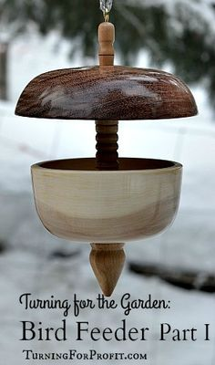 Turned Bird Feeders Finished and waiting for the birds.  Combines both spindle and bowl turning to produce a stunning wooden bird feeder.  Part I shows you how to turn the central dowel for the feeder.