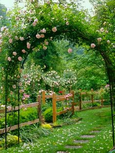 Beautiful pale pink climbing roses on arbor with perennial garden and trees.  I like the fence idea - wouldn't work for sheep, but would for horses and cattle.