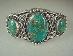 green turquoise on silver scroll bracelet