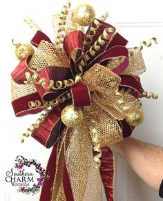 Custom made Christmas Tree Topper in gold and burgundy theme by Southern Charm Wreaths. www.southerncharmwreaths.com