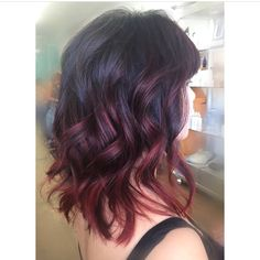 Wavy Shoulder-Length Hair with Chunky Layers and Red/Violet Balayage