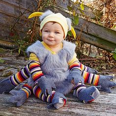 For this sweet little costume, pair a soft one-piece and a knitted hat with a comfy vest. Then, add legs galore!