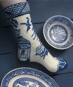 """Knit your favourite plates. Ravelry: Willow Ware pattern by Lisa Grossman. """"The sixth sock in the 2012 Tsock Flock """"Art for your Feet"""" club. Kit will be available to the public some time in 2014. Details on my blog [link at Ravelry]. If you would like to be notified, please sign up for the mailing list. 'Blue Willow' colorway for this kit dyed exclusively for Tsarina of Tsocks by Moose Manor Hand Paints."""""""
