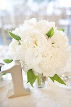 Fresh white peonies and garden roses and silver table number.   Love the silver number