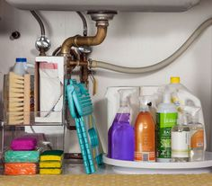 Organize Kitchen Cleaning Supplies: The Strategy  Storing soaps, sprays, and sponges under the sink is a natural fit—you want to keep them hidden. Just make sure that everything is easily accessible, so you don't have to move 18 different spray bottles just to reach the extra roll of paper towels.