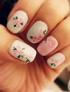 Floral and feminine best describes this rose-covered manicure.   - MarieClaire.com