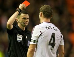 Weat Ham's Kevin Nolan is shown a red card for a bad tackle on Jordan Henderson