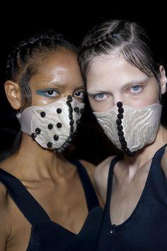 Models with masks backstage at Masha Ma's Paris Fall/Winter 2014 Fashion Week show. (Courtesy Photo)