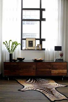 eclectic mix of modern clean-lined classics coupled with warm woods, rich fabrics and industrial antiques