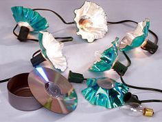 Turn old music CDs into trendy wavy-shaped lampshades for strings of patio lights.