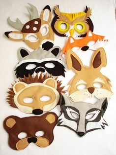 Animal Felt Masks.  Love these! Nice change from the usual paper masks. Kids could make their own, but use glue instead of needing to sew ... hmmm ... Wolf, Bear, Owl, Fox, Rabbit, Raccoon, Hedgehog, Deer