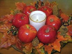 Autum leaves, apples, pinecones with a candle make an easy yet beautiful centerpiece.
