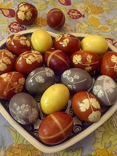The beautiful reddish brown eggs are the traditional Armenian way to dye Easter eggs.  The traditional decoration is the cross design shown in the photo.  Over the years, I've experimented with the leaf design pictured here.