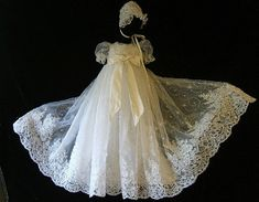 """Daddy better start saving in case the next one is a little girl :) - Angela West Christening Gowns For some parents, heirloom translates to handmade. The gown shown here is from the """"Oriana"""" line and incredibly ornate. Made of silk and lace, this 40"""" gown is embellished with hand-sewn sequins, pearls and crystal beads. The hem is offset by with a high quality re-embroidered lace and additional trimmings."""