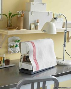 Keep sewing machine gears dust-free with a good-looking tea towel cover.