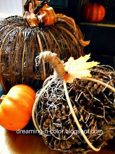 Creamy Caramel Pumpkin Potpourri.  You need:    Chicken Wire,  pine cones,  basket reeds or bendable branches,  jute,   silk fall leaf, and   pumpkin scented oil (optional).